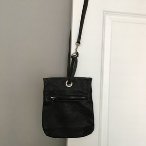 Roots small cross body leather bag